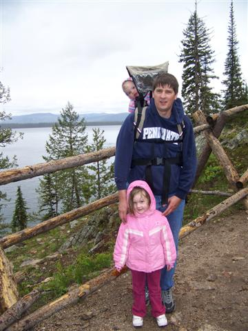 A great Daddy not only takes the kids on hikes, but carries them and makes sure they are shelterd from the rain.